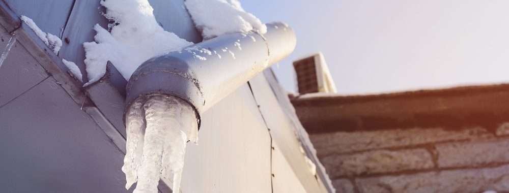 frozen pipes on exterior of building